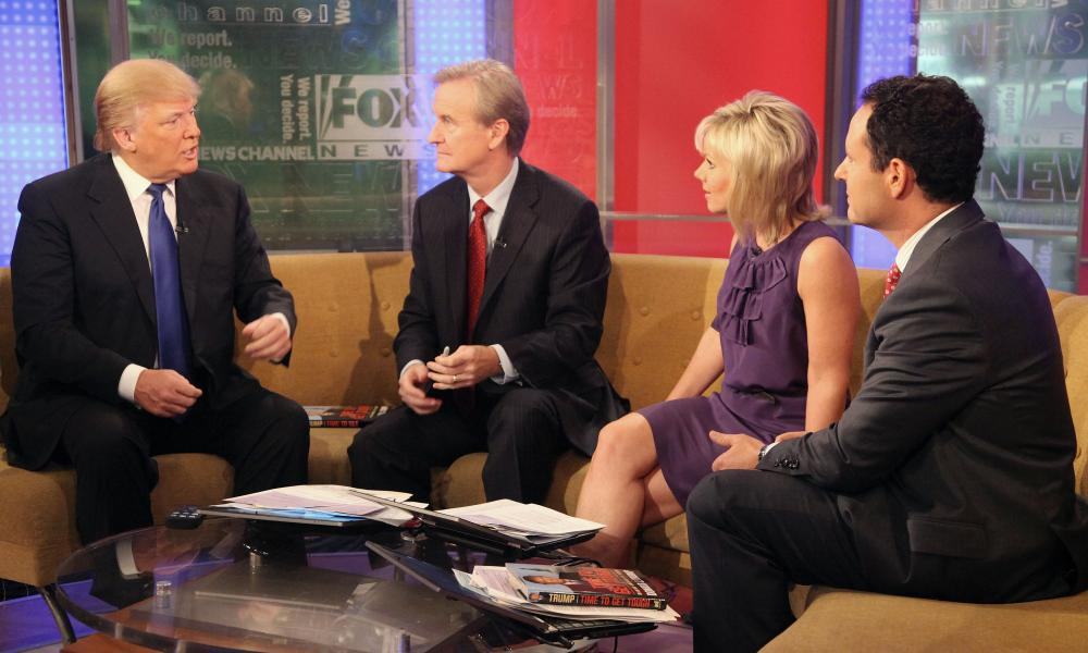 Donald Trump talks with 'FOX & Friends' hosts Steve Doocy, Gretchen Carlson and Brian Kilmeade at FOX Studios on December 6, 2011.