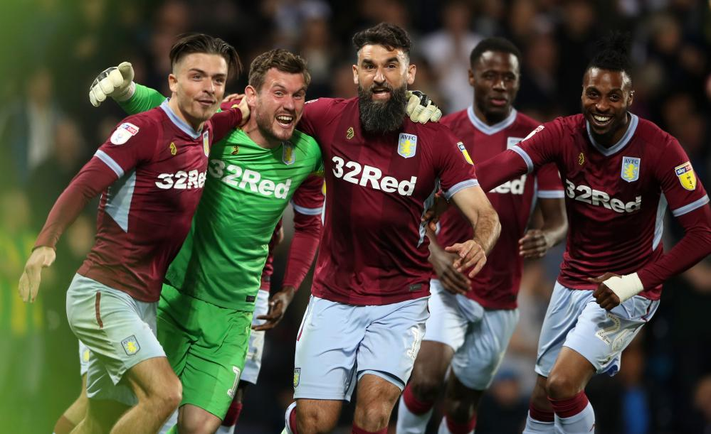 Aston Villa's keeper Jed Steer (second left) celebrates victory with Jack Grealish (left) and Mile Jedinak.