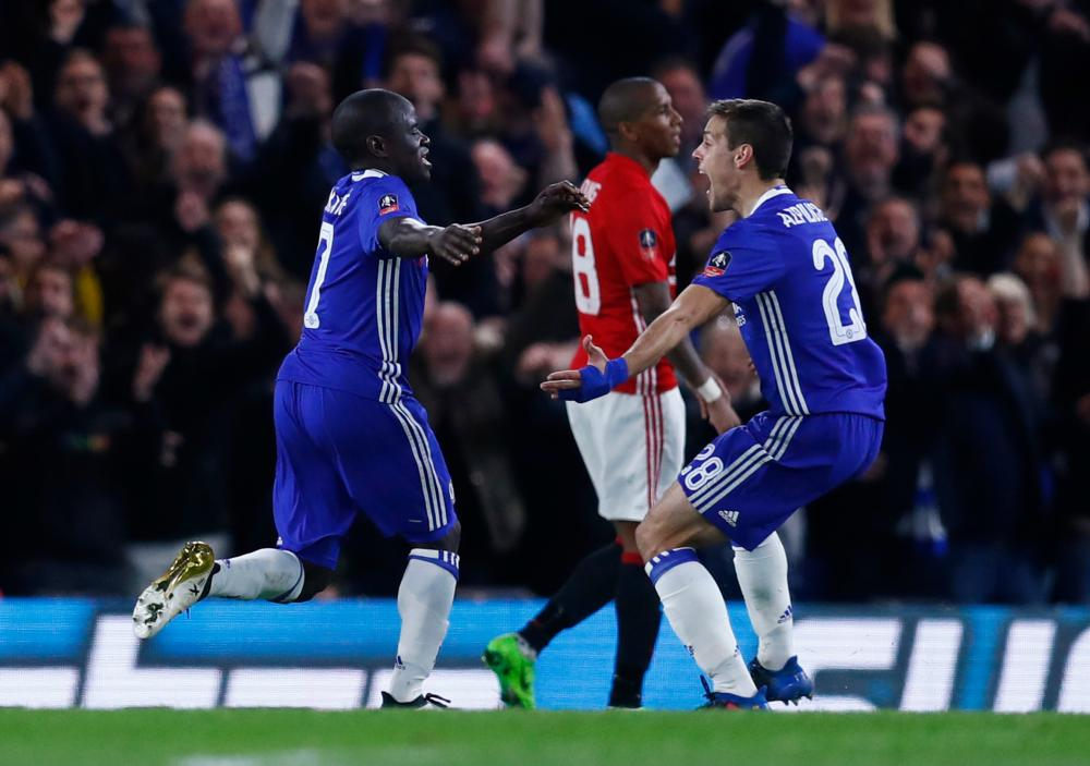 Kante celebrates scoring th first goal with Cesar Azpilicueta.