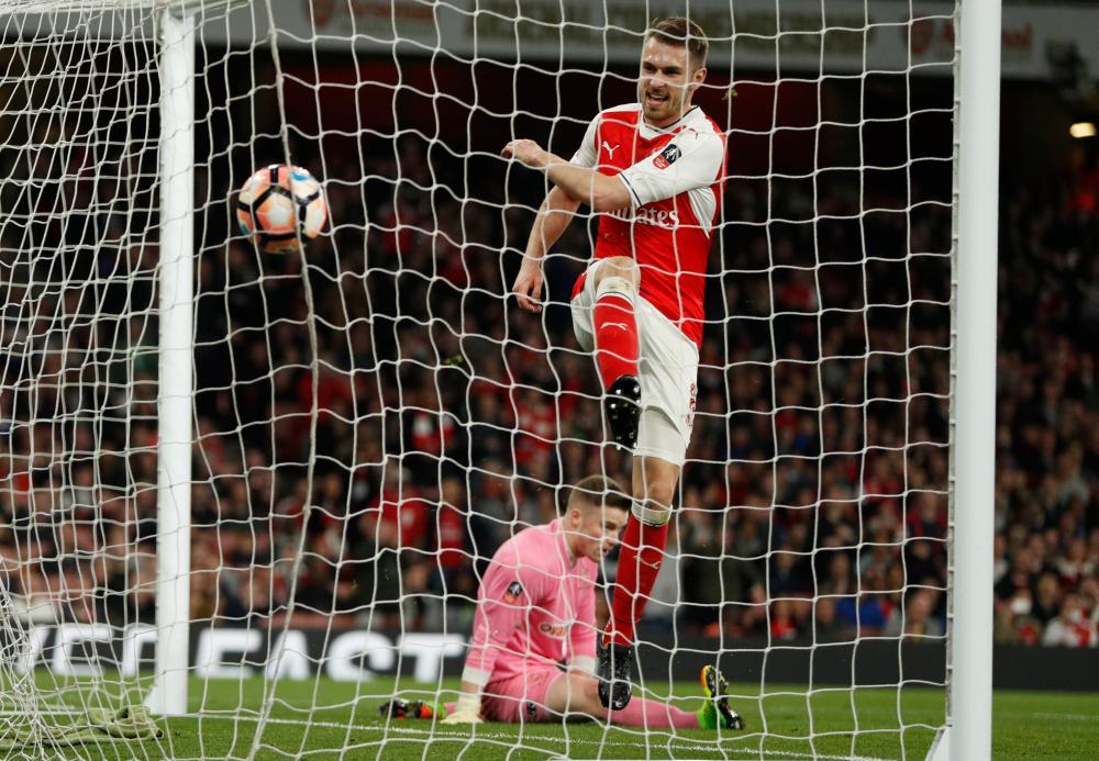 Arsenal's Aaron Ramsey scores their fifth goal.