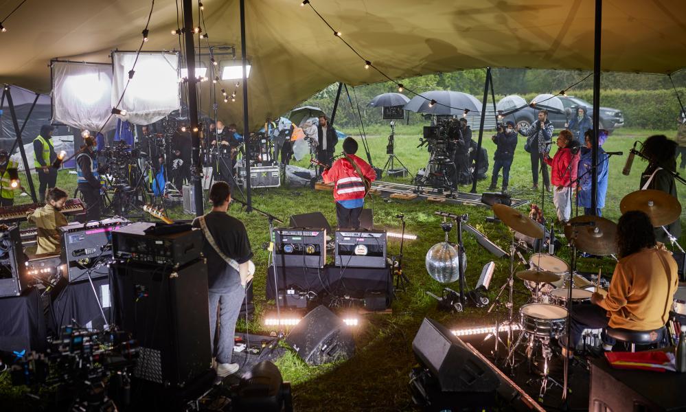 A heavy downpour of rain during Michael Kiwanuka's set.