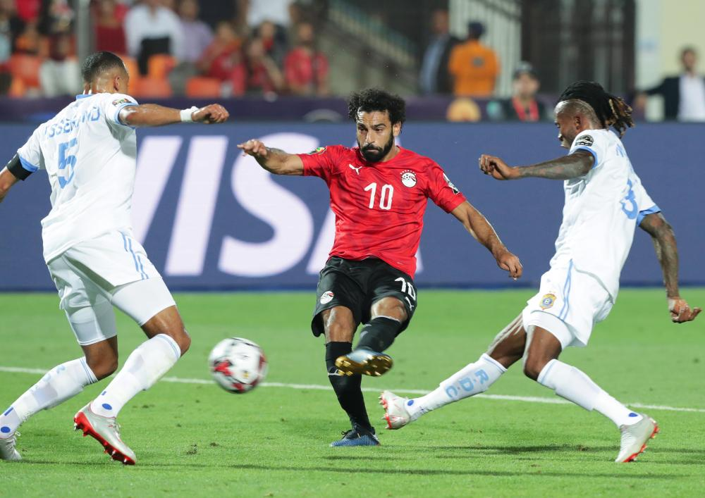A fine finish from Mohamed Salah (centre) doubles Egypt's lead.