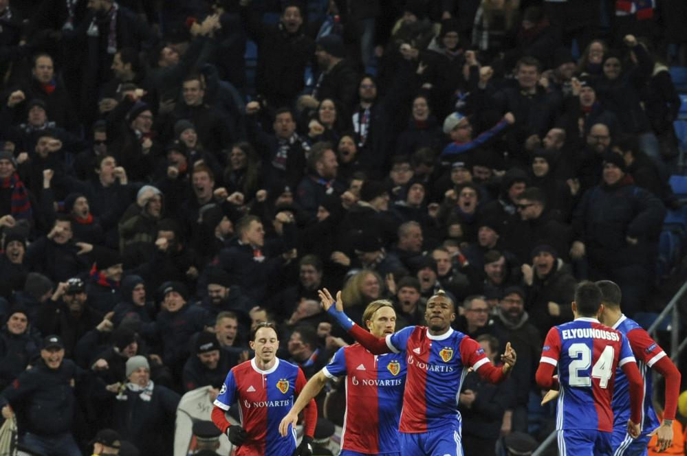 Basel's Michael Lang, second from left, celebrates with his team-mates infront of some rather happy Basel fans.