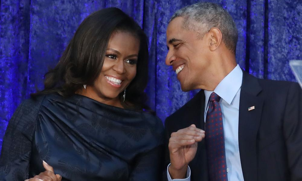 Barack Obama and Michelle Obama participate in the unveiling of their official portraits during a ceremony at the Smithsonian's National Portrait Gallery on Monday in Washington DC.