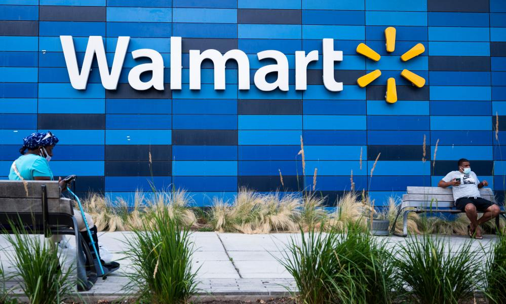 People sit outside a Walmart store in Washington, DC