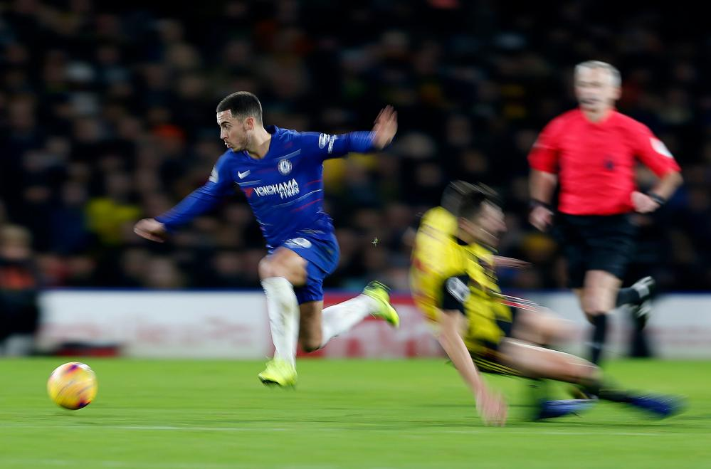 December 26: Eden Hazard of Chelsea leaps away from a tackle by Craig Cathcart of Watford at Vicarage Road.