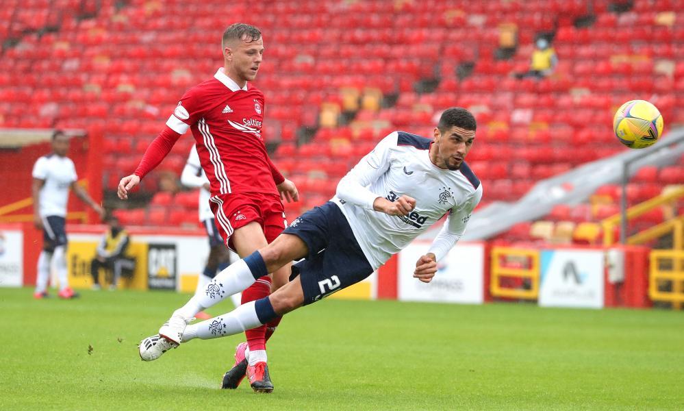 Rangers' Leon Balogun beats Bruce Anderson of Aberdeen to a header.