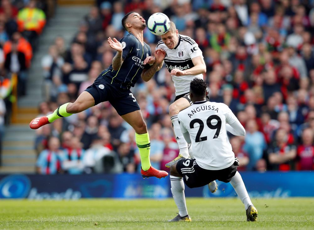 Manchester City's Gabriel Jesus in action with Fulham's Maxime Le Marchand.