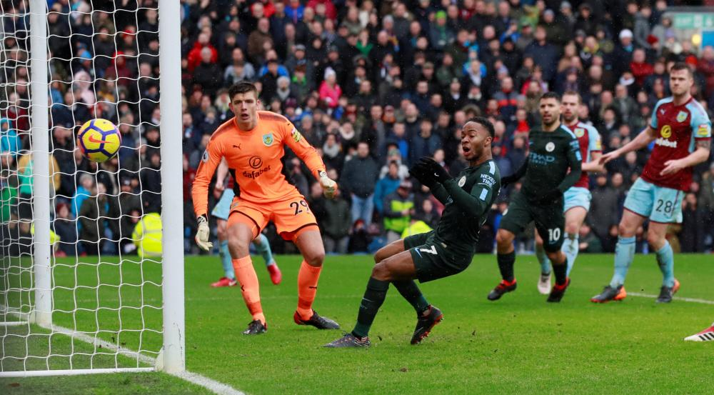 Raheem Sterling inexplicably puts the ball wide from very close range.