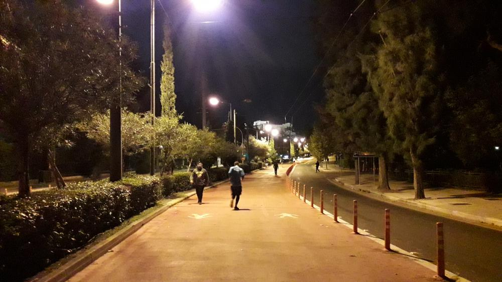 Athenians exercising at night beneath the Acropolis.