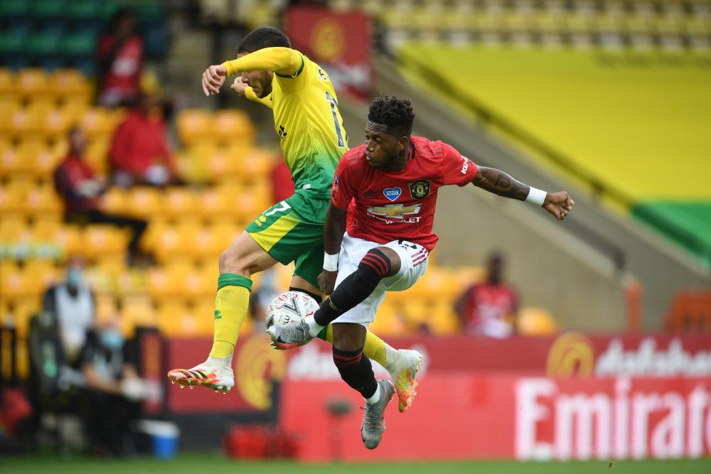 Norwich City's Emiliano Buendia battles for possession with Fred.