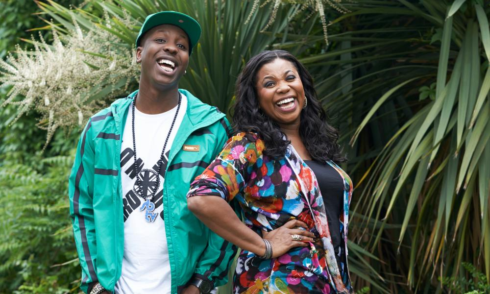Jamal Edwards with Brenda, his mum, in their garden, smiling
