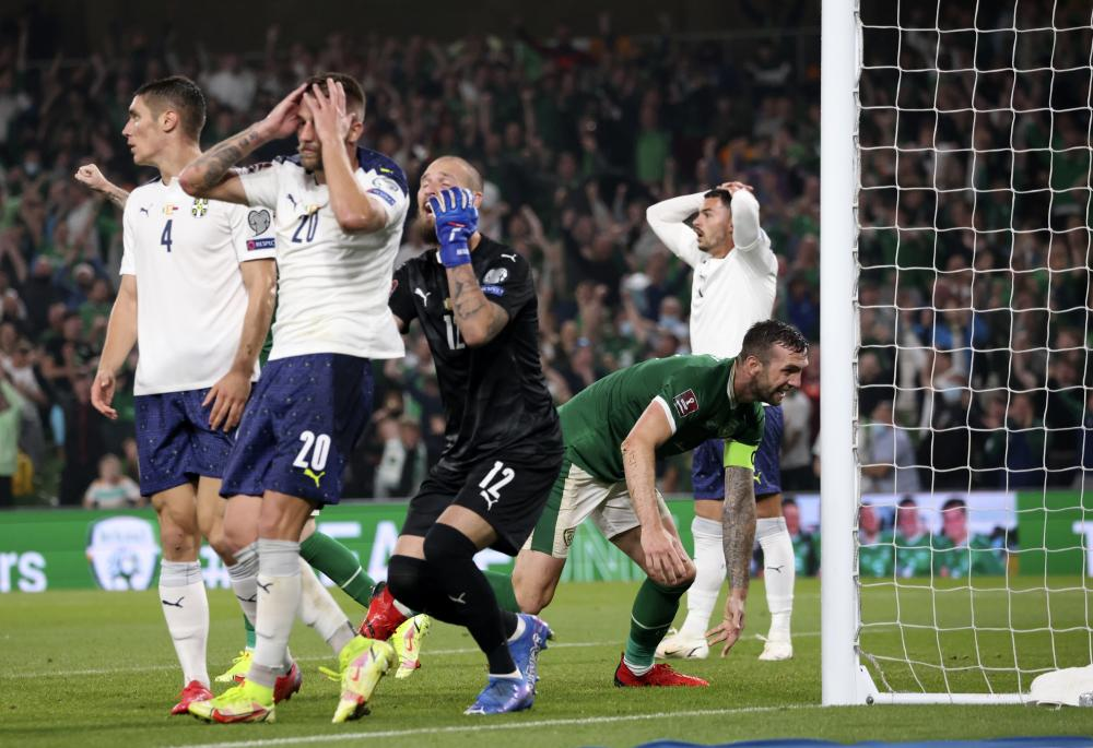Serbia's Sergej Milinkovic-Savic, second left, and his teammates react after scoring an own goal late in the game.