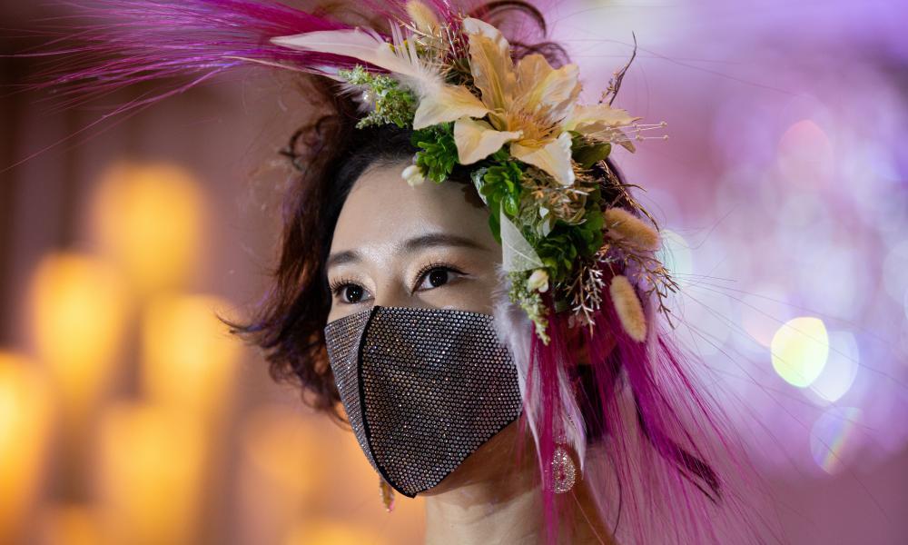 A model looks on during the 2020 Korea Mask Fashion show in Seoul, South Korea.