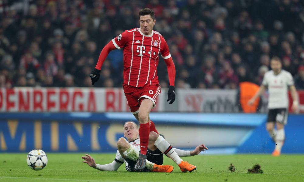 Robert Lewandowski is taken down by Domagoj Vida.