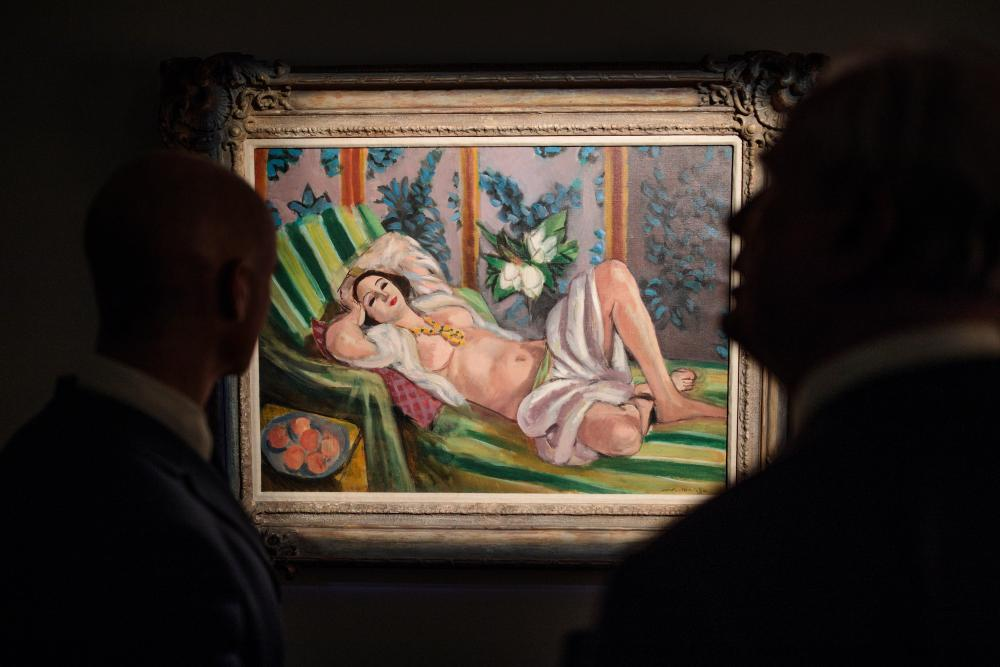 'Startling sensuality': Christie's staff with Matisse's Odalisque couchée aux magnolias.