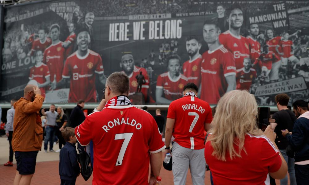 Fans gather outside the ground to celebrate the return of Cristiano Ronaldo.