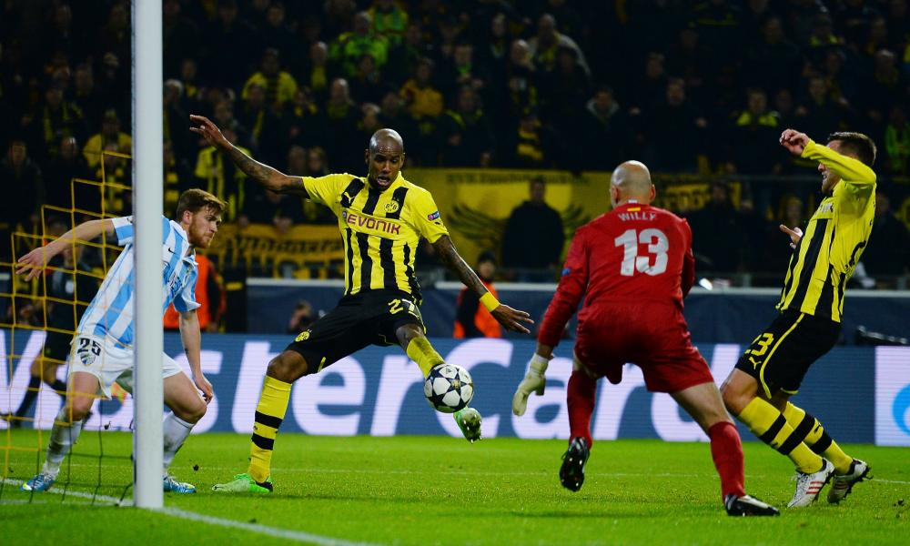 Felipe Santana of Borussia Dortmund scores their winning goal in injury time to complete a remarkable comeback against Málaga and reach the 2013 semi-finals.