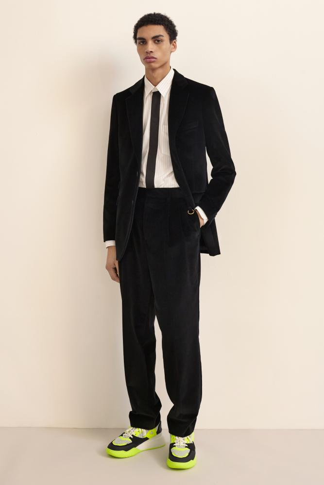 Suits and trainers by Stella McCartney.