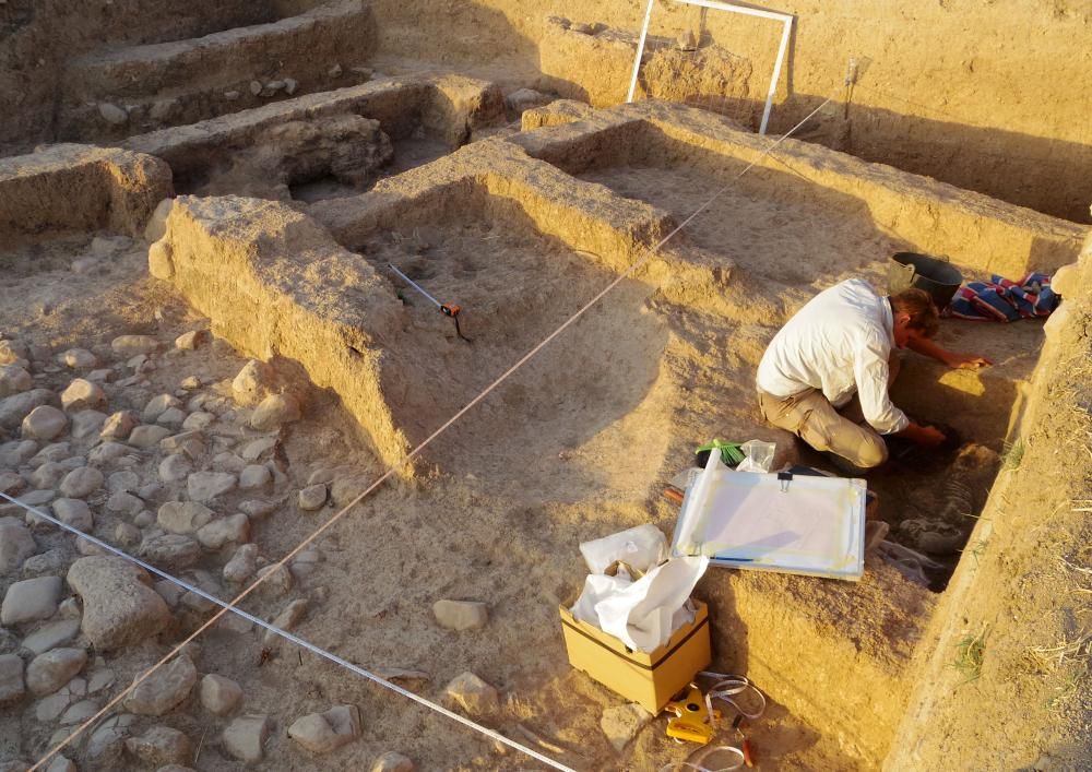 The tripartite house at Gurga Chiya under excavation. Ben removes a burial from one of the small rooms off the central hall.