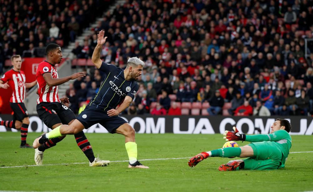 Southampton's Alex McCarthy makes a save from Manchester City's Sergio Aguero