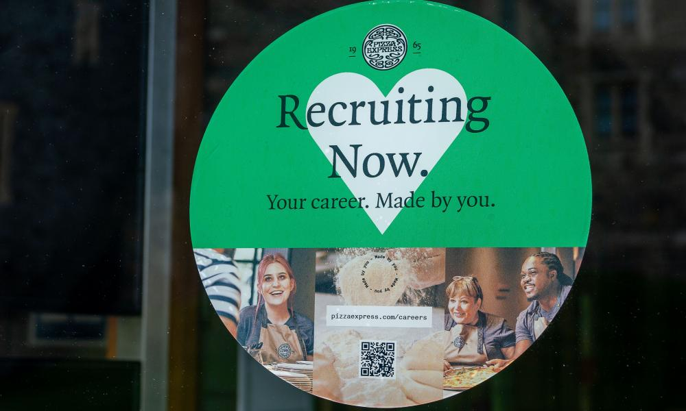A recruitment sign in Pizza Express