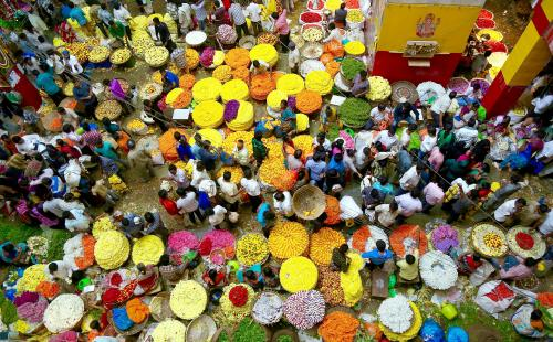 Hindu devotees buy flower garlands before the last day of the Durga Puja festival