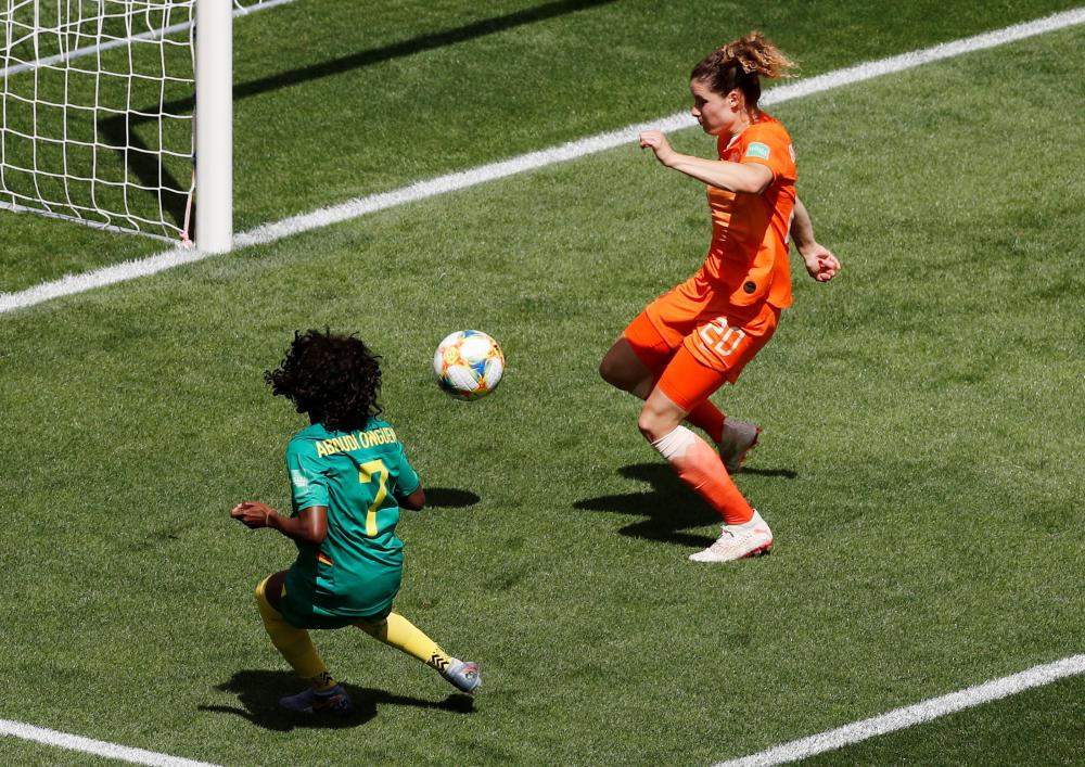 Cameroon's Gabrielle Aboudi Onguene slots in the equaliser.