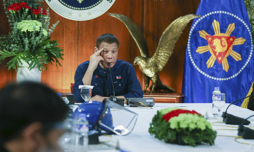 Rodrigo Duterte talks to members of the Inter-Agency Task Force at the Malacanang presidential palace in Manila on Thursday