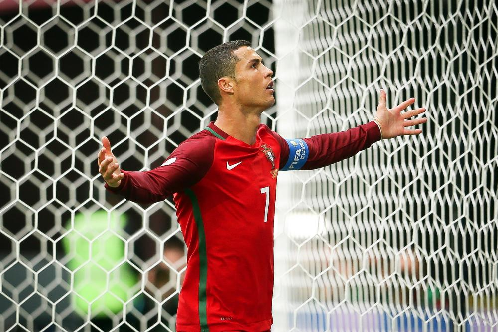 Cristiano Ronaldo celebrates after opening the scoring from the penalty spot.