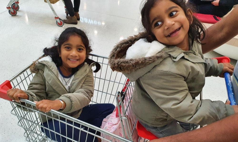 Tharnicaa and Kopika at a supermarket after being reunited in Perth earlier this year.