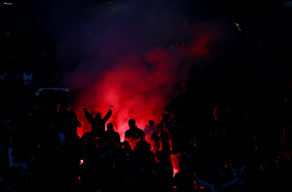 The Benfica fans set off a flare in the stands.