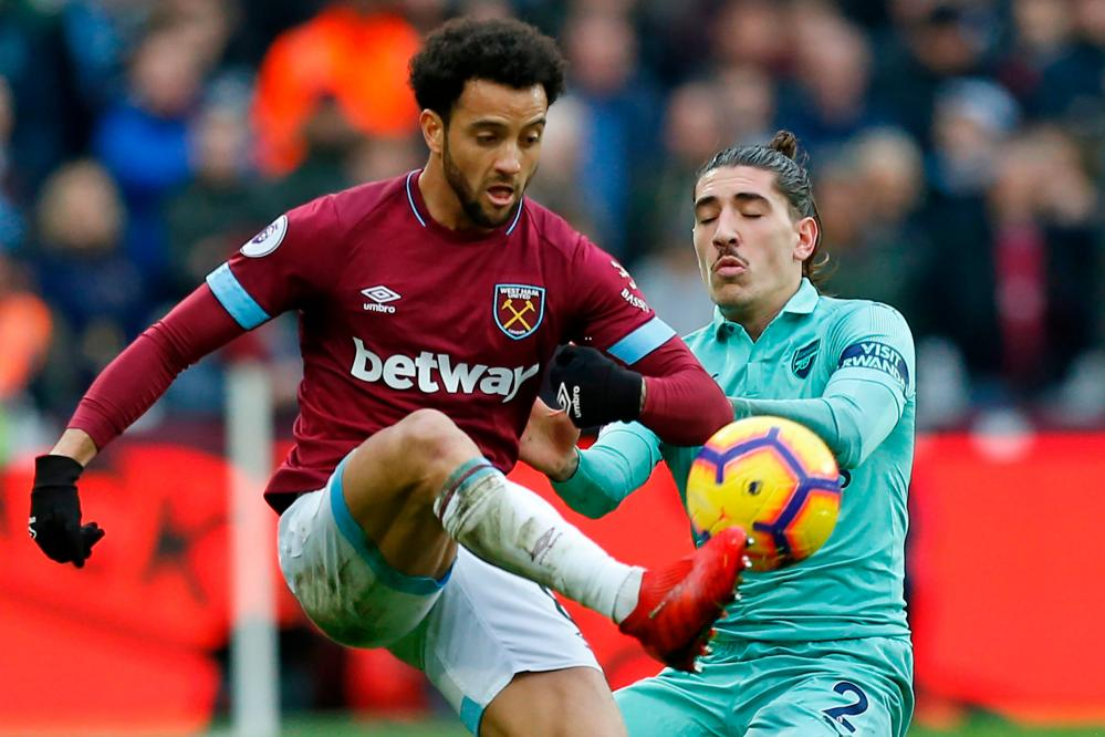 Felipe Anderson gets the better of Hector Bellerin.