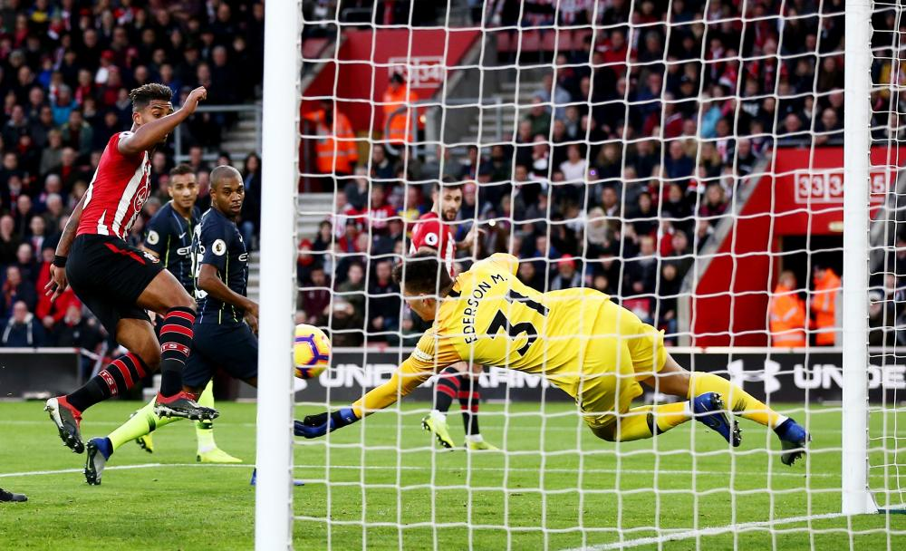 Ederson of Manchester City makes a save from the header by Charlie Austin of Southampton.