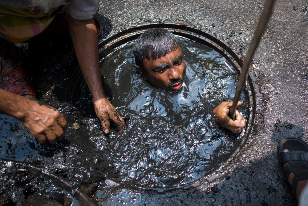 A sewer cleaner of in Dhaka, Bangladesh.