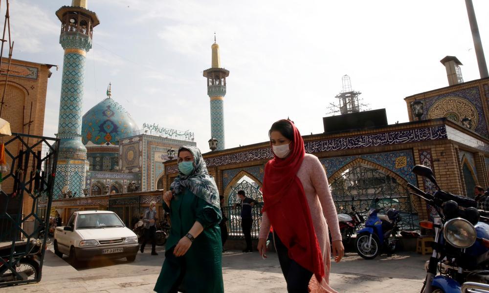 Iranian women wearing face masks walk past next to the Saleh shrine in Tehran, Iran, 26 October 2020.