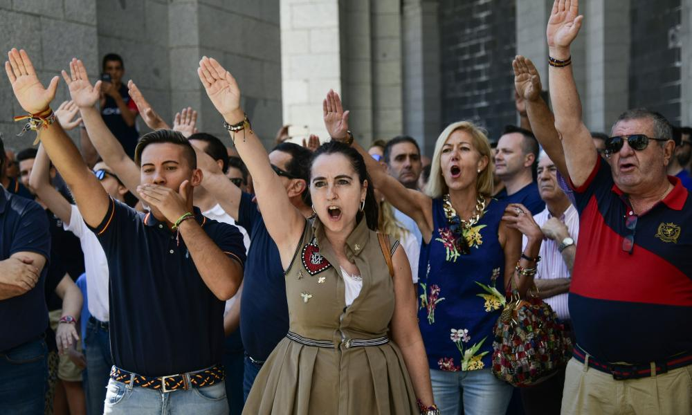 People make the fascist salute at the Valley of the Fallen, near Madrid, in July 2018, protesting against the proposed removal of Franco's remains from the mausoleum.