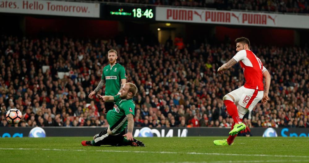 Arsenal's Olivier Giroud scores their second goal.