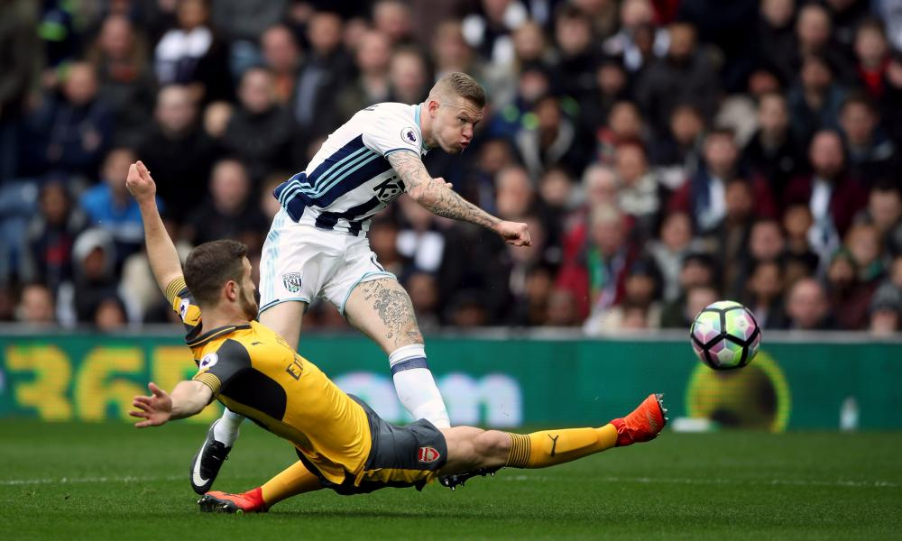 West Brom's James McClean thumps a shot goalwards but Petr Cech is more than equal to it and pushes the ball behind.