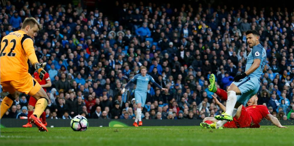 Manchester City's Sergio Aguero scores the equaliser against Liverpool to make the score 1-1