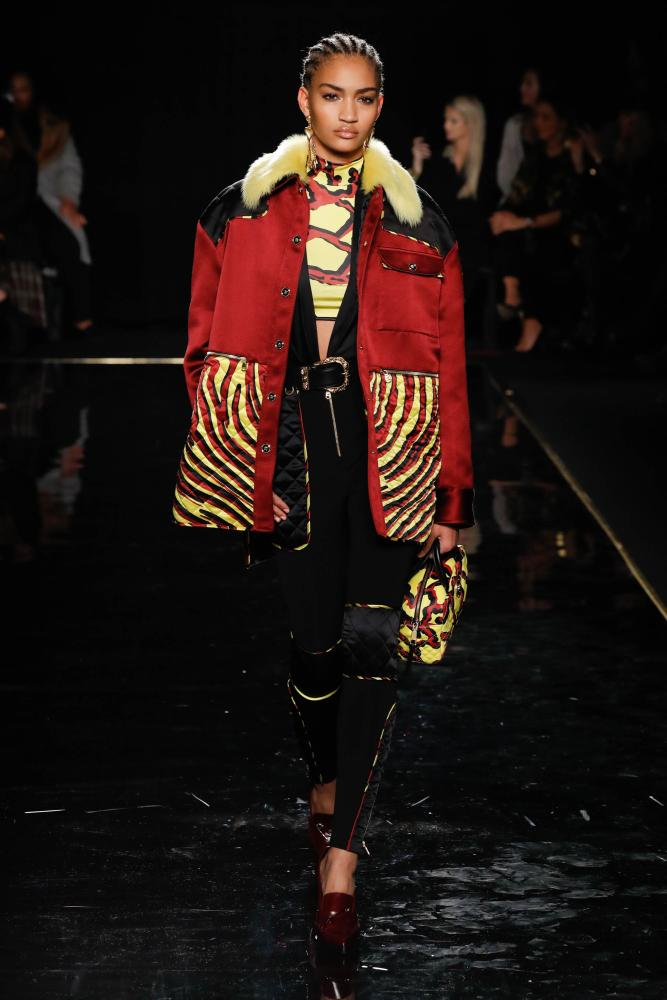 A model walks the runway at the Versace show where accessories, especially bags, were also emphasised.