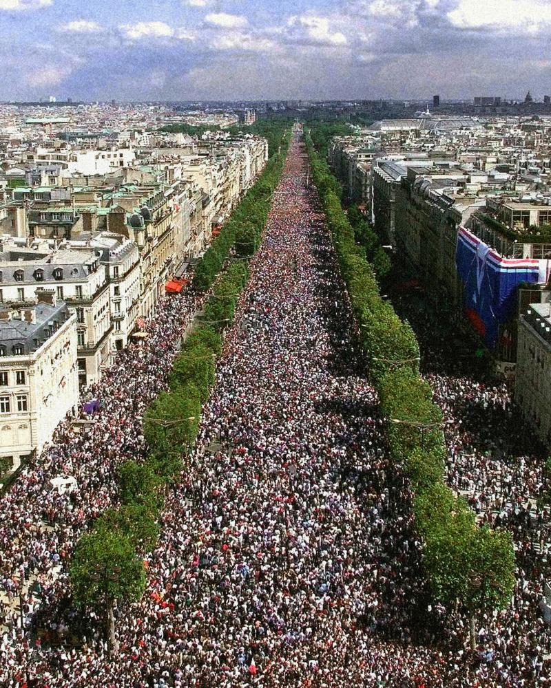 Crowds celebrate in the Champs-Élysées after France won the football World Cup in 1998.