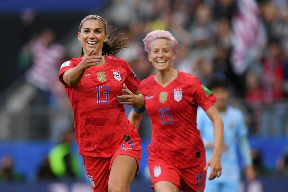 Alex Morgan celebrates after scoring the United States' first goal.