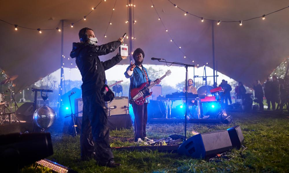 Behind the scenes at Michael Kiwanuka's performance inside a tent in the Icon field.