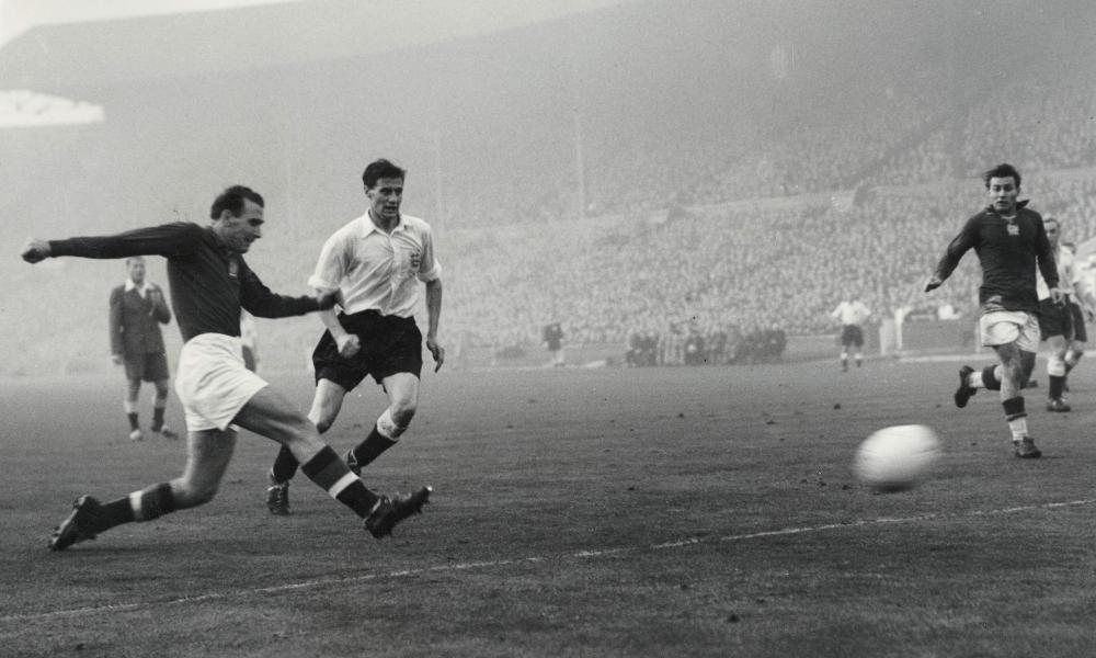 The legendary Nandor Hidegkuti wears Hungary's famous red shirt, here pictured in black and white. Oh England!