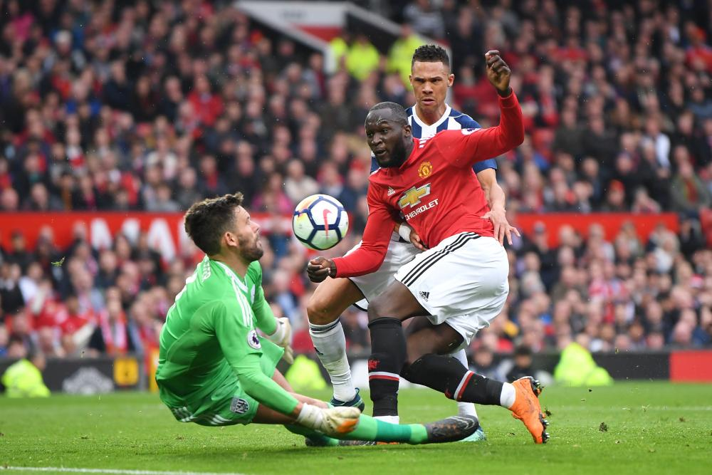 Foster uses his face to save from Lukaku.