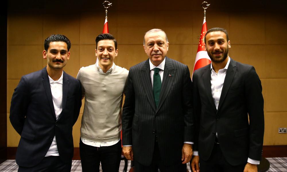 Ilkay Gundogan, Mesut Ozil and Cenk Tosun are pictured with Recep Tayyip Erdoğan.