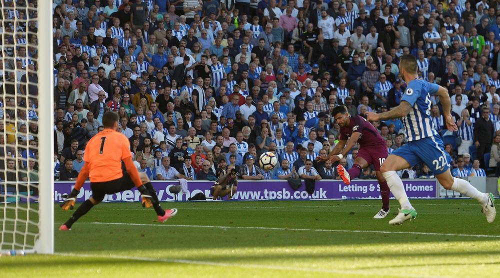 Sergio Aguero fires the ball past goalkeeper Ryan.
