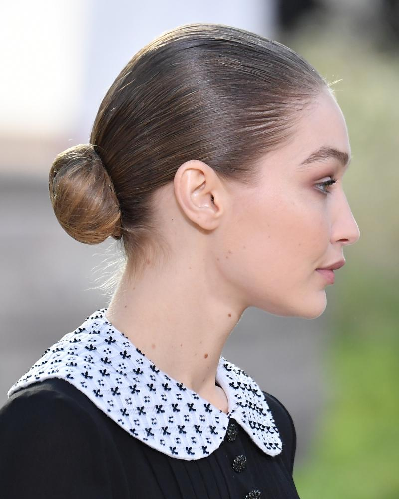 Gigi Hadid wears a chic bun on the runway.
