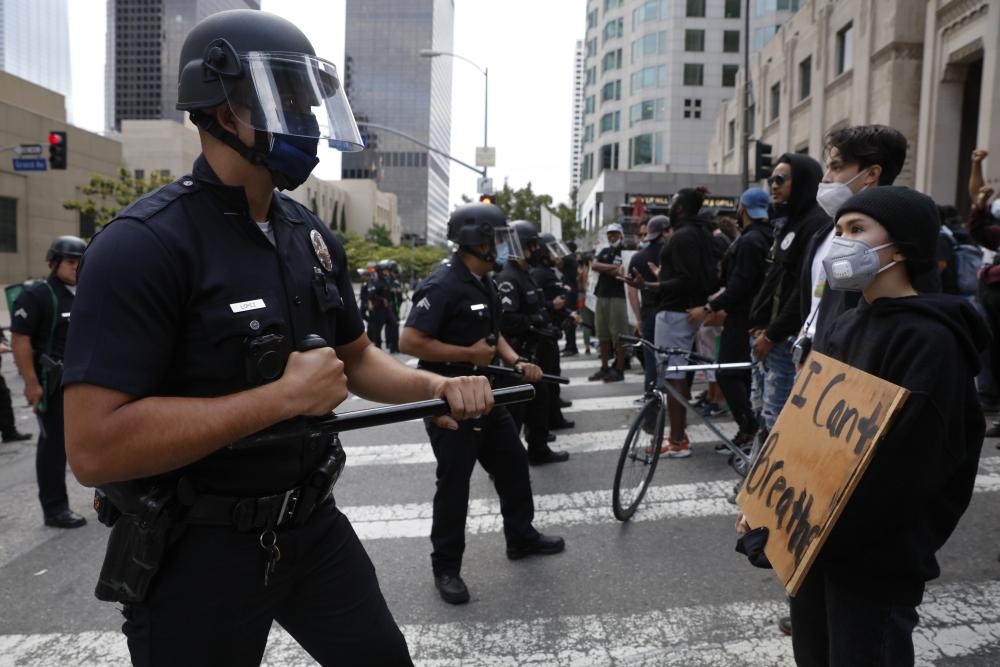 Protesters confront police officers during a demostration over the death of George Floyd, Friday, May 29, 2020, in Los Angeles. Floyd died in police custody on Memorial Day in Minneapolis. (AP Photo/Jae C. Hong)